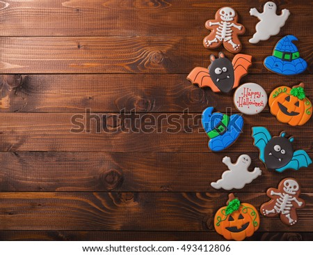 Funny delicious ginger biscuits for Halloween on the old wooden table.