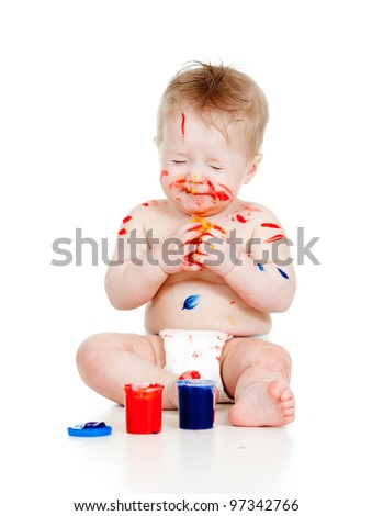Funny dirty child with paints. Isolated on white background - stock photo