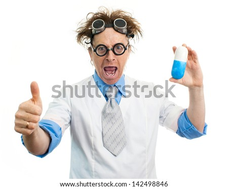 Funny doctor holding a pill - stock photo