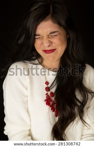 Funny expression with woman eyes shut tight - stock photo