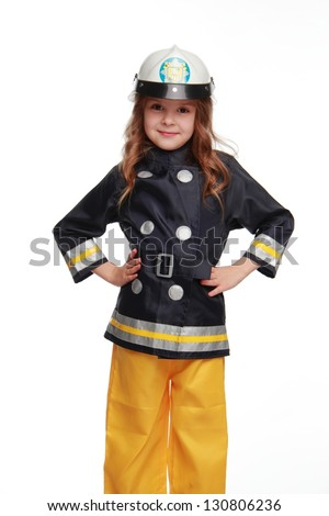 Funny face emotional little girl in a bright dress firefighter on white background