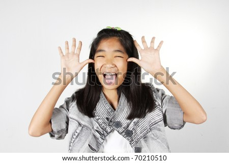 Funny face, Girl with funny face fooling around. - stock photo