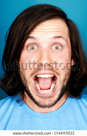 Funny face man portrait real silly fun expression - stock photo