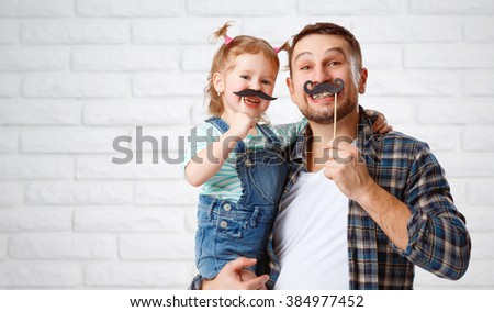 funny family father and child daughter with a mustache - stock photo