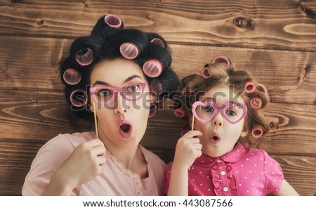 Funny family! Mother and her child daughter girl with a paper accessories. - stock photo