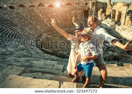 Funny family take a self photo in amphitheater building.Side,Turkey - stock photo
