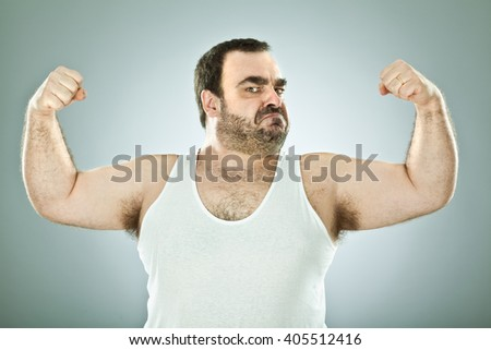funny fat macho man isolated on grey - stock photo