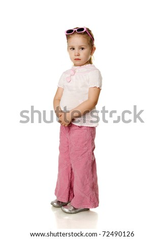 Funny four years girl standing on floor isolated on white