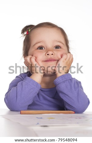 funny girl drawing at the table on a white - stock photo
