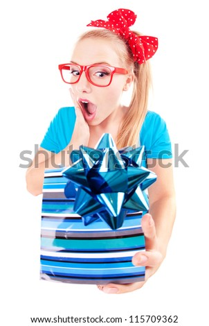 Funny girl excited by getting a present - stock photo