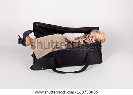 Funny girl in a big bag shows sign of silence - stock photo
