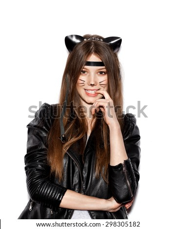 Funny girl represents as small cat.  Woman  with bright makeup hairstyle of girl with leather cat ears having fun. On white background not isolated - stock photo