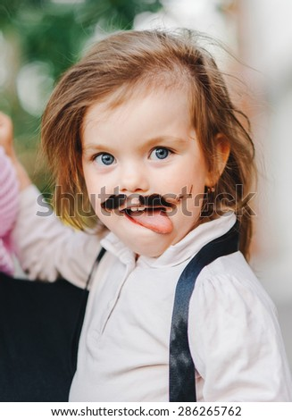 funny girl showing tongue - stock photo