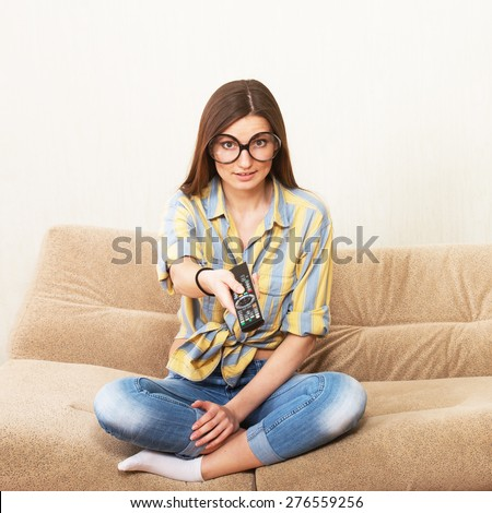 Funny girl watching TV - stock photo
