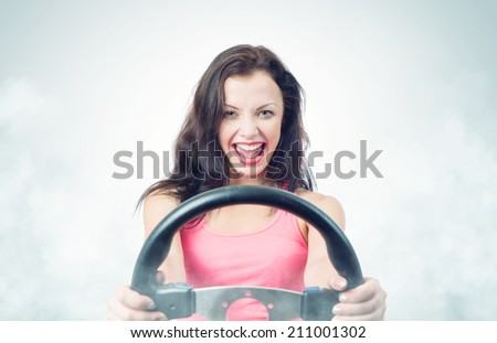 Funny girl with car wheel and smoke - stock photo