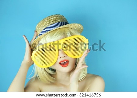Funny girl with funny glasses, Happy naughty blonde hair woman with giant sunglasses. Woman in crazy clown glasses, Large funny glasses. - stock photo