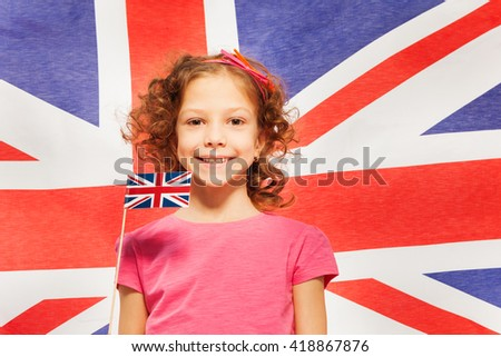Funny girl with little flag against British banner
