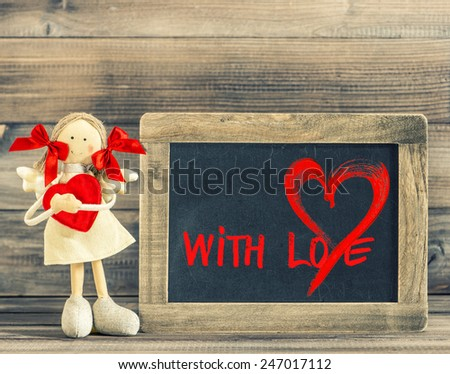 Funny girl with Red Heart. Valentines Day decoration with blackboard and text With Love - stock photo