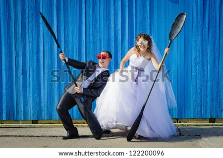 funny Groom and Bride with oars - stock photo