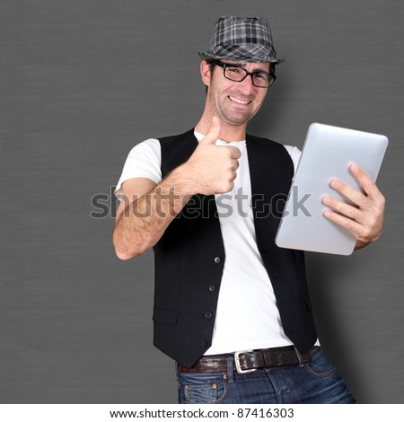 Funny guy using electronic tablet - stock photo
