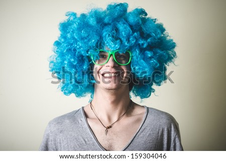 funny guy with blue wig singing on white background - stock photo