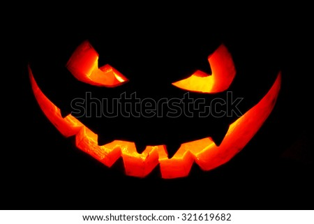 Funny Halloween Jack O' Lantern pumpkin smile isolated on black background - stock photo