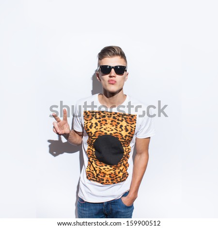 funny handsome man with hipster glasses smiling - stock photo