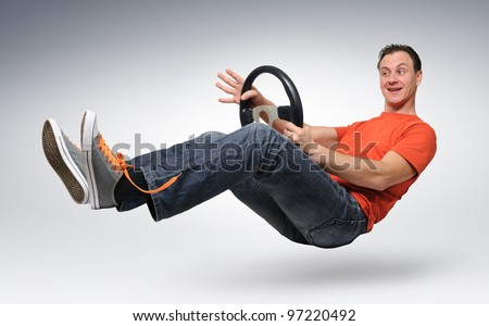 Funny happy man car driver with a wheel, auto concept - stock photo