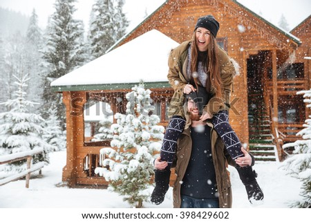 Funny happy young couple having fun together in winter  - stock photo