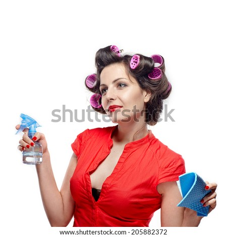 Funny housewife with rag / wipe and cleaning spray for window. - stock photo