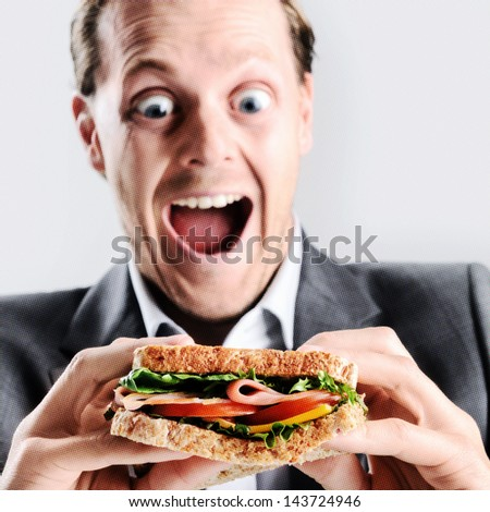Funny humourous man eating a sandwich with exaggerated wide eye comical expression. with pixeled effect for pop art style - stock photo