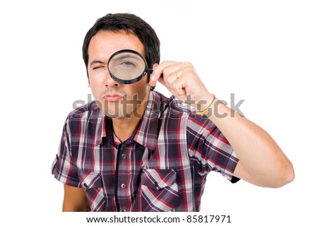 Funny image of a young man looking through magnifying glass, isolated on white - stock photo