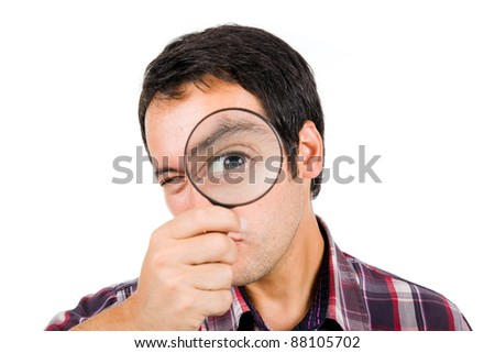 Funny image of a young man playing with a magnifying glass, isolated on white - stock photo