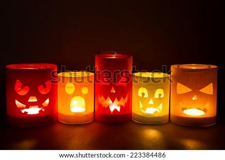 Funny jack-o-lanterns on a dark background - stock photo