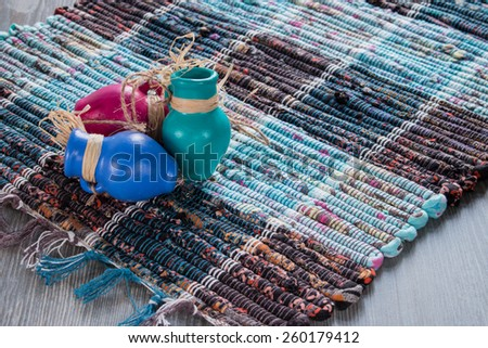 funny jugs on the mat - stock photo