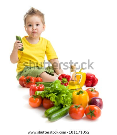 Funny kid boy eating vegetables. Healthy food concept. - stock photo