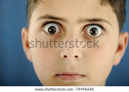 funny kid boy with big surprised eyes - stock photo