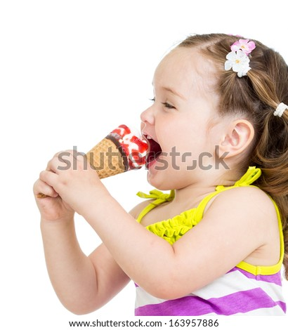 funny kid girl eating ice cream isolated - stock photo