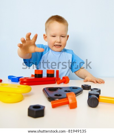 Funny kid playing with color parts - stock photo