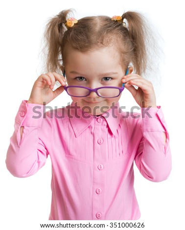 Funny kid putting on spectacles isolated - stock photo