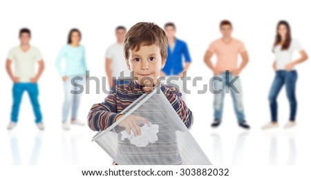 Funny kid throwing a role in the bin with young people of background unfocused - stock photo