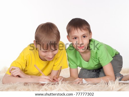 funny kids drawing on the floor on a white