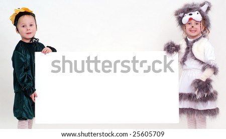 Funny kids holding big blank sheet of paper - stock photo