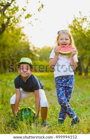 Funny kids taste watermelon. Child Healthy Eating