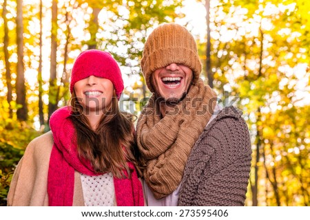 funny laughing couple hidden faces - stock photo