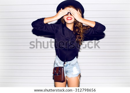 Funny lifestyle portrait of crazy girl closed her eyes,emotional and happy mood,chic clothes and summer hat outdoors.Soft warm vintage color tone.Stylish sweater and hat.smiling laughing,autumn colors - stock photo
