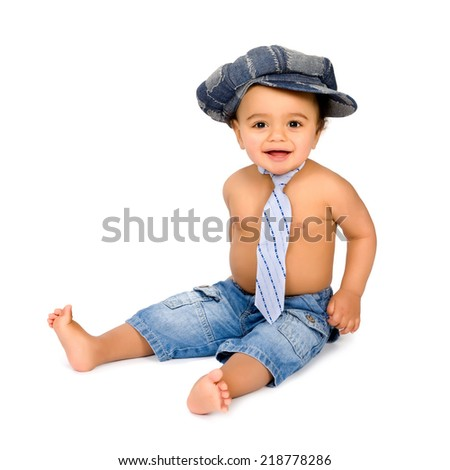 Funny little African baby boy with hat and tie - stock photo