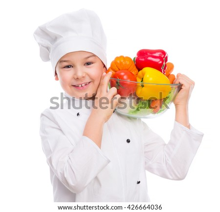 funny little boy-cook in uniform holding bowl with vegetables in hands isollated on white background - stock photo