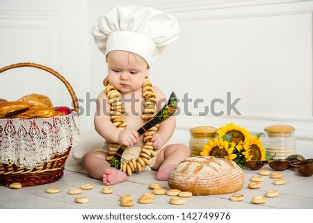 Funny little boy in a suit cooks - stock photo