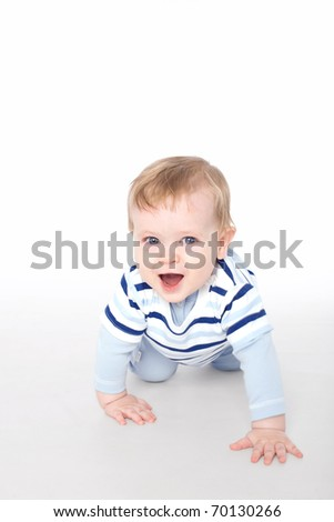Funny little boy on the floor - stock photo